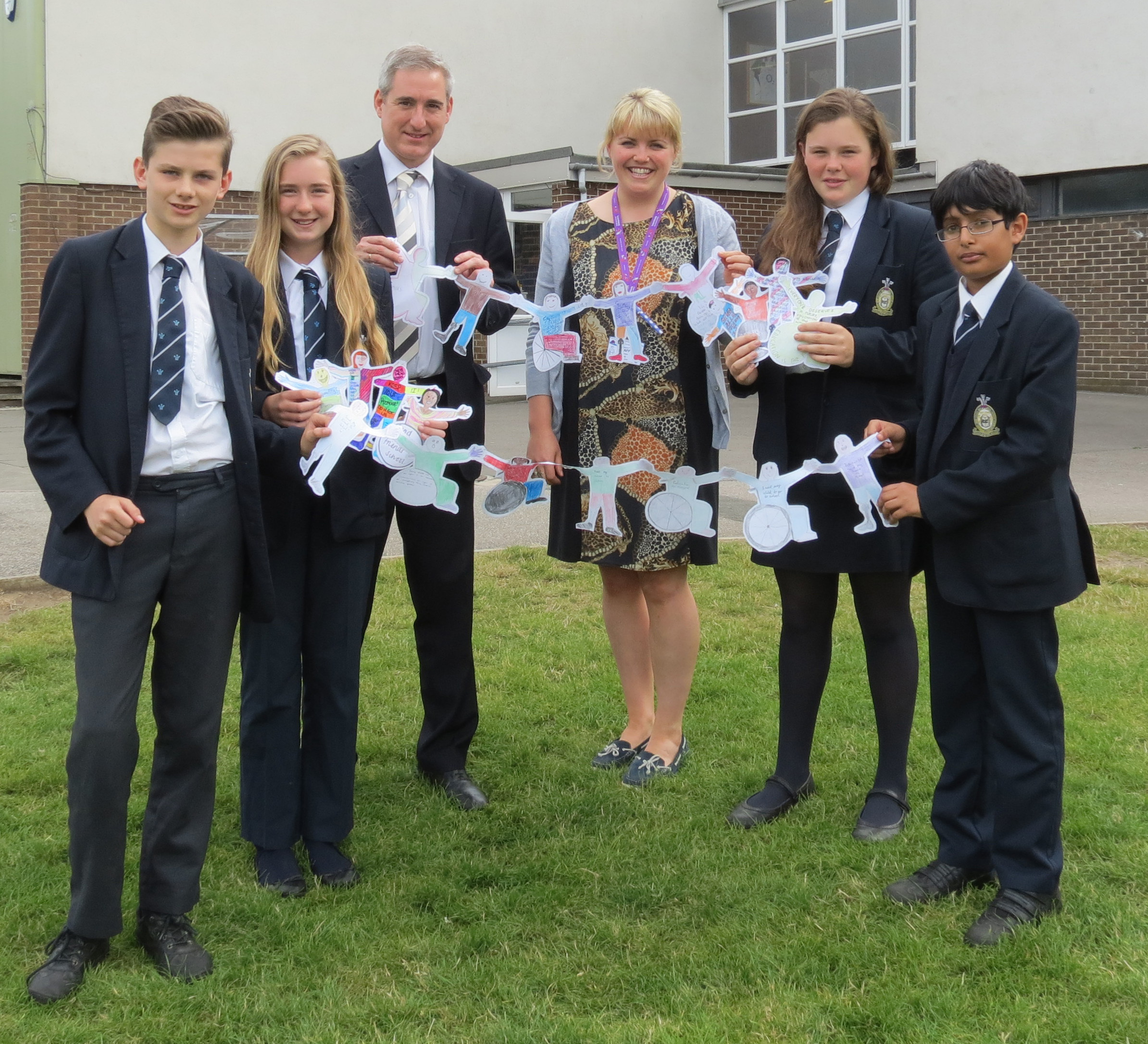 (L to R): Showing their support for the Send My Friend to School campaign at Prince Henry's Grammar School - Tom Winter, Laura McPherson, Greg Mulholland MP,