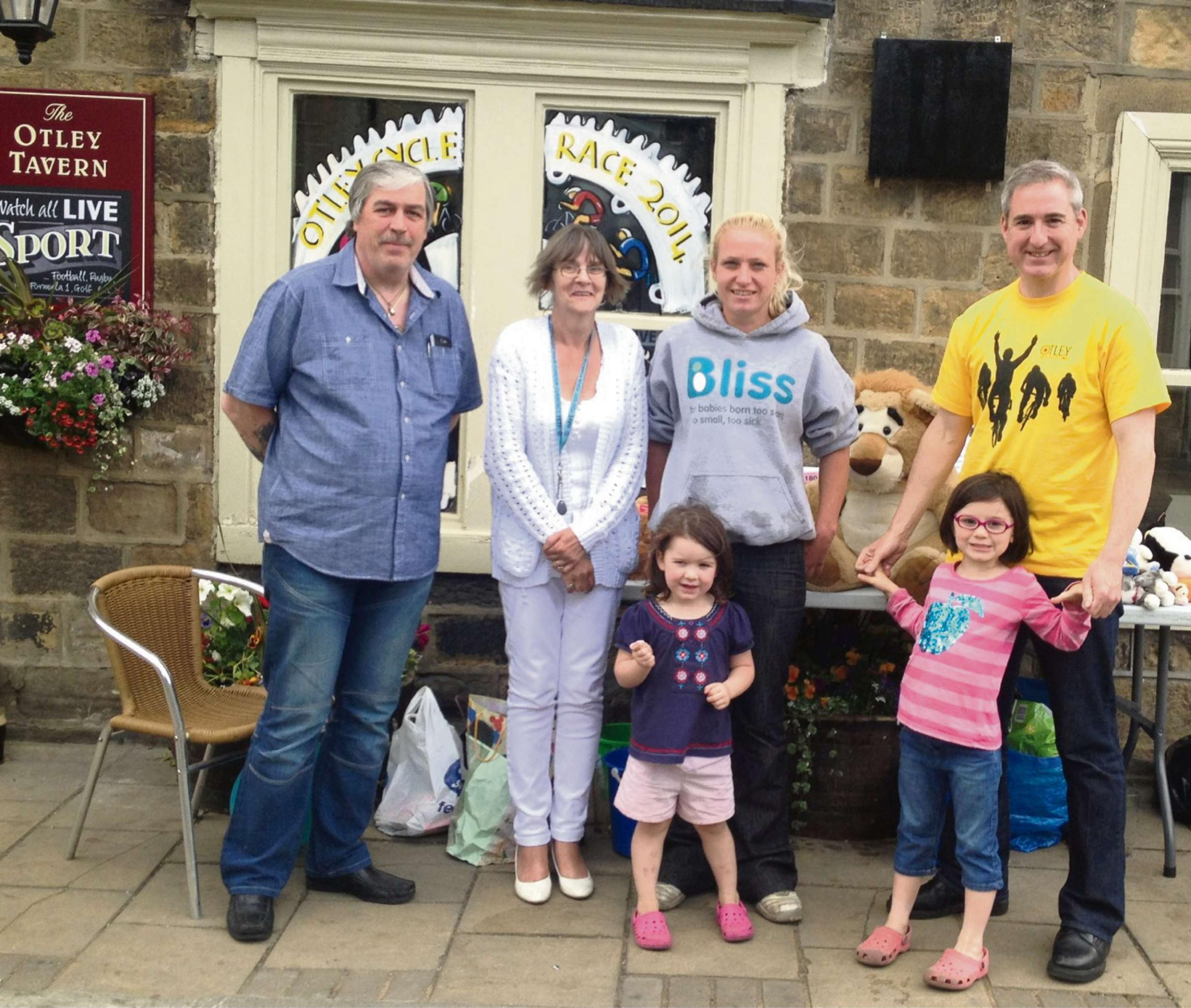 (Left to Right): Peter and Fiona Jackson, licensees of The Otley Tavern, with Bliss fundraiser Mel Metcalfe and MP Greg Mulholland, joined by two of his daughters.