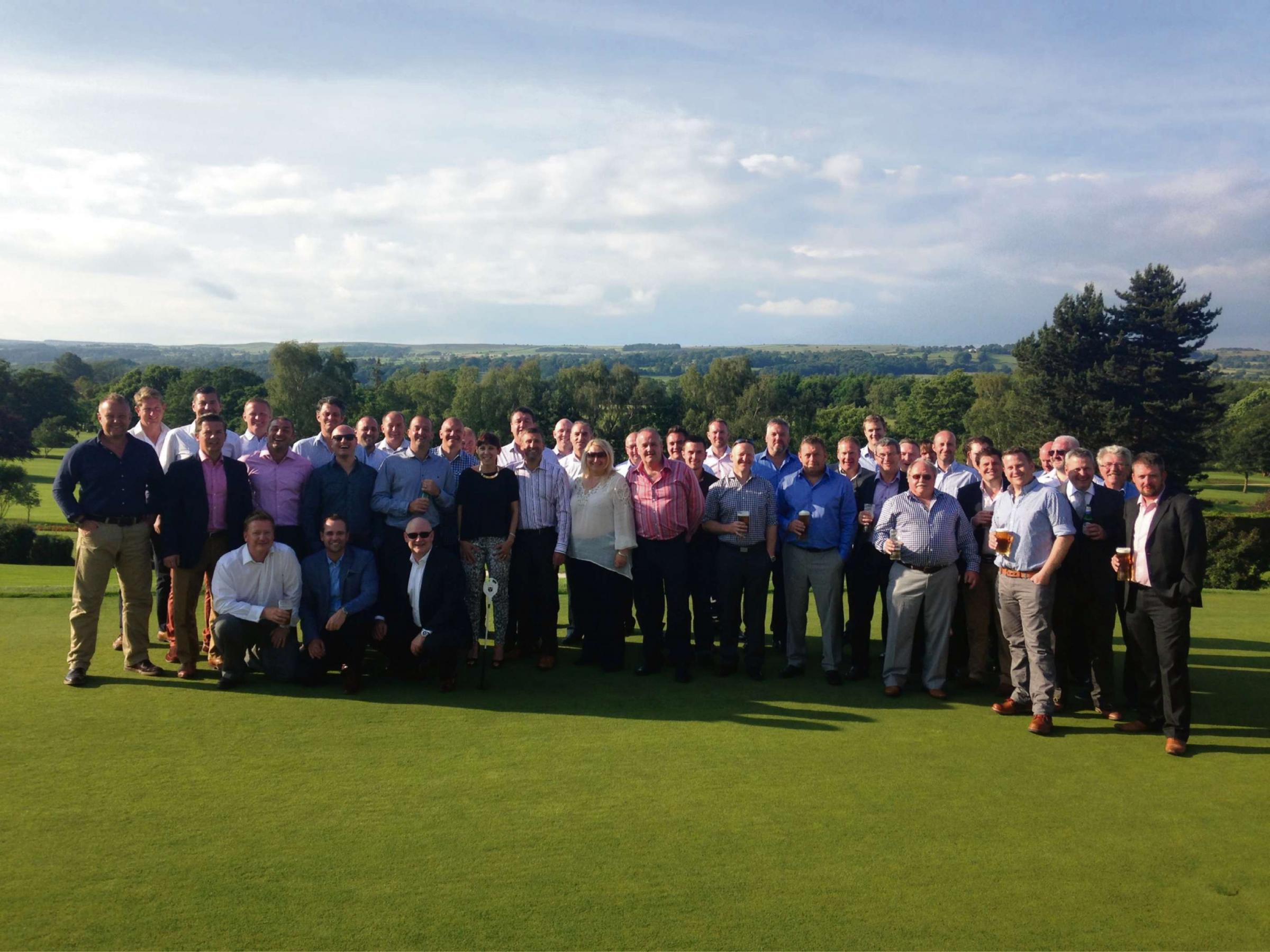 The competing teams enjoying the sunshine following the 2014 KM Norris Ltd and Strasse Porsche Specialists UK Ltd charity golf day at Otley Golf Club. The annual event has now raised