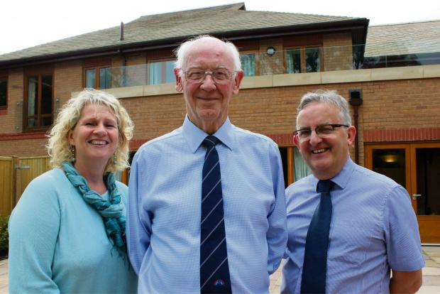 Robin Wood reitres as Chairman of Francis House Children's Hospice. L-R Gill Bevin -Head of Care, Robin Wood, Revd David Ireland -Chief Executive Francis House.