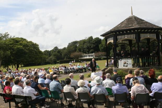 The service in the park in Horsforth. Pictured standing in front of the Bandstand is Horsforth town councillor Richard Hardcastle after reading out a quarter of the names of the 249 war dead