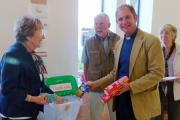 submitted pix: The Rev Rob Hilton of Christchurch contributes to the Churches Together in Ilkley Food bank collection point at Booths. (8740028)