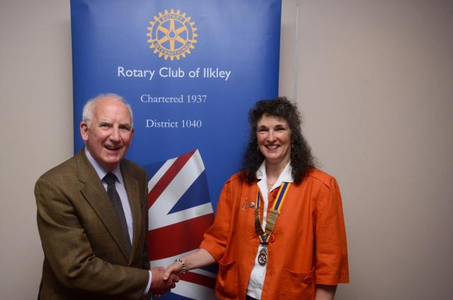 (8656447)Newly elected Ilkley Rotary Club president, Dawn Emsley, accepts the chain of office from past president, John Metcalf