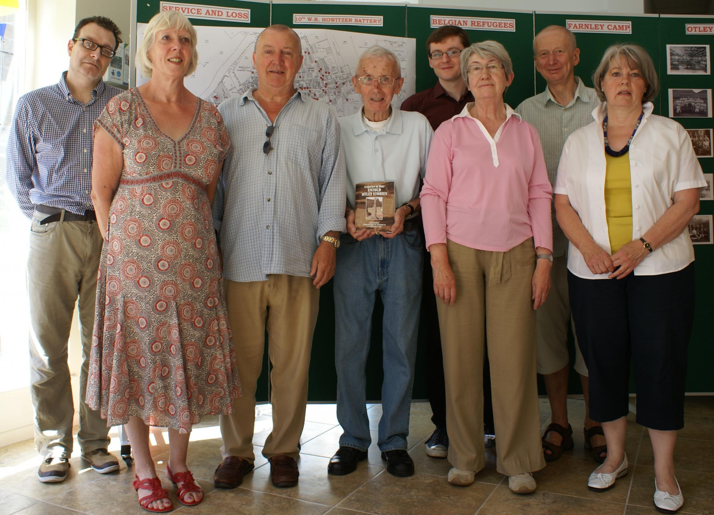 Historian and project member Bill Mulholland (centre, holding book), with fellow Otley Museum volunteers (Left to right): John Wenmoth, Jill Allman, Jim Caswell, Neil Adams, Meryl Auty, Andrew Howard, and Sue Teasdale.