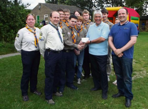 9th Airedale and Tenzing Explorer Scout Alexander Lofthouse (centre, shaking hands) accepting a £500 donation from Otley Lions' past youth officer, George Chapman (second from right) and Lion Gareth Dibble (far right).
