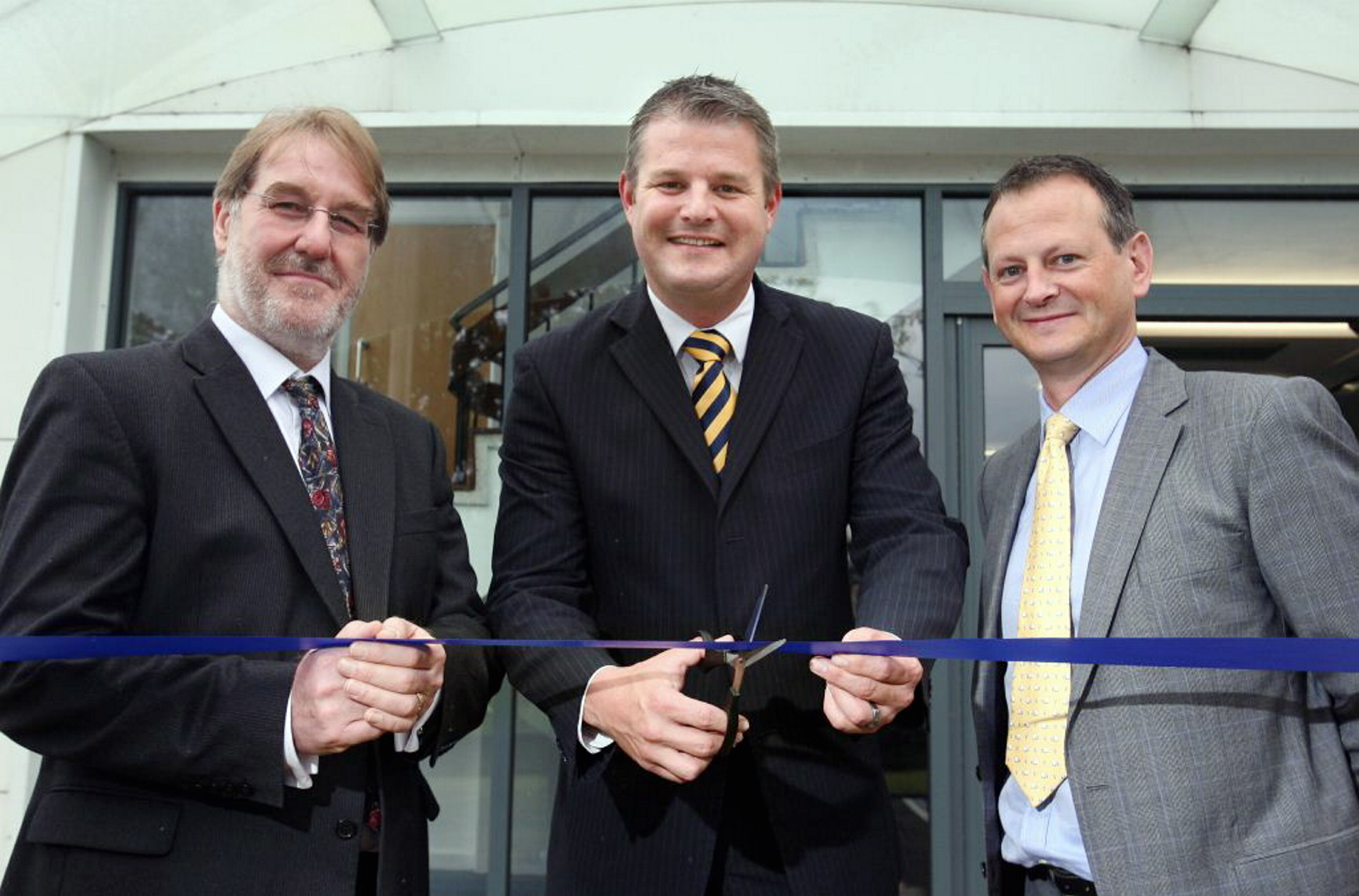 Stuart Andrew MP cuts the ribbon to open EMIS new offices in Rawdon... L-R: Chris Spencer, EMIS Company Secretary, Stuart Andrew, Sean Riddell, EMIS Chief Executive