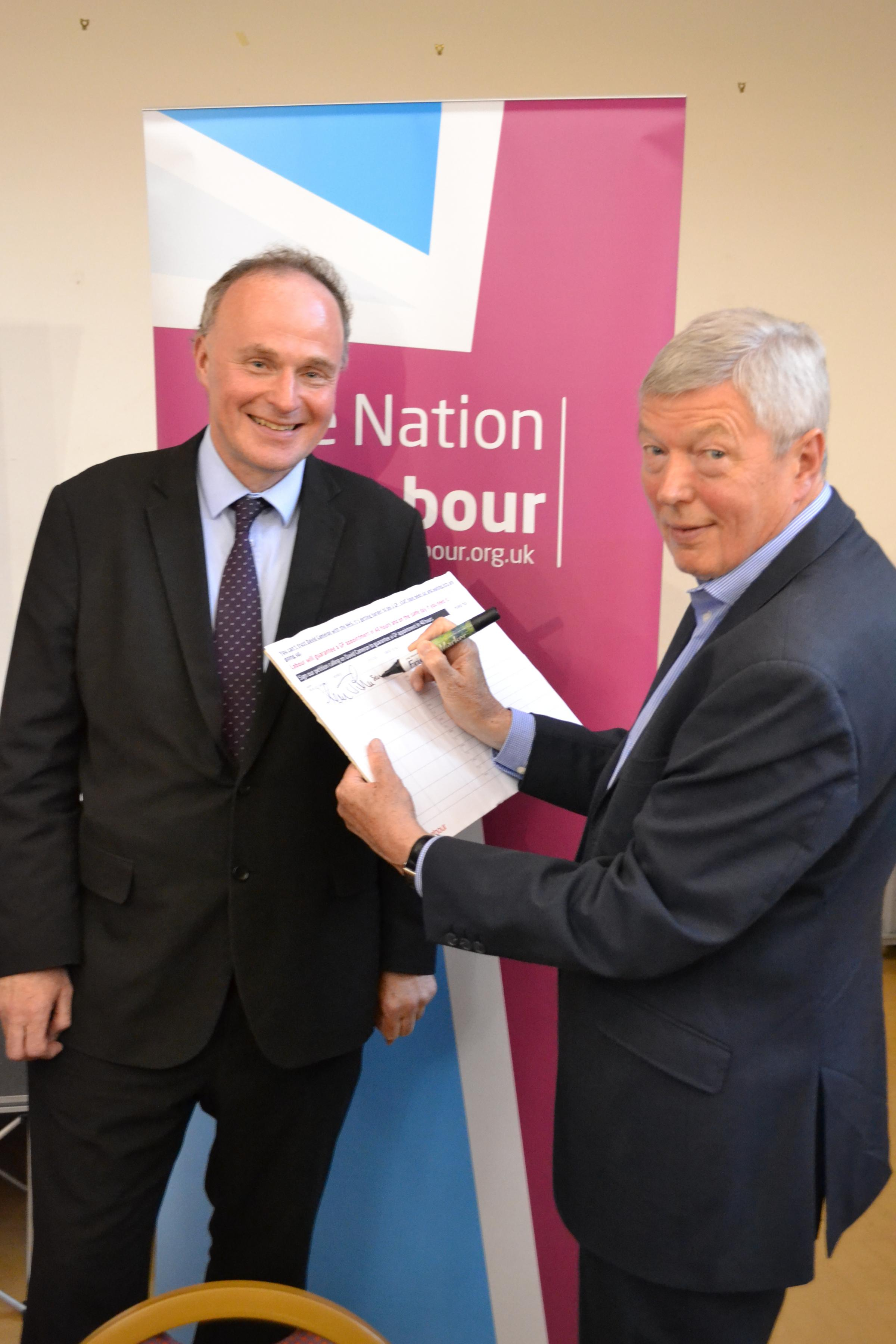 (9152956)Former Health Secretary Alan Johnson (right) signing the petition with Labour Keighley constituency candidate, John Grogan