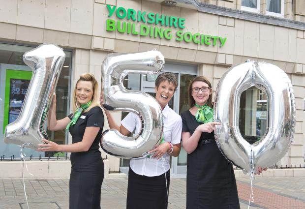 Yorkshire Building Society colleagues Katie Brown, Chris King and Hannah Bell launch the cash giveaway to celebrate the Society's 150th anniversary.