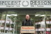 (9875535)David Giddings outside Opulent Designs on The Grove, with the Broadbents bookseller's sign