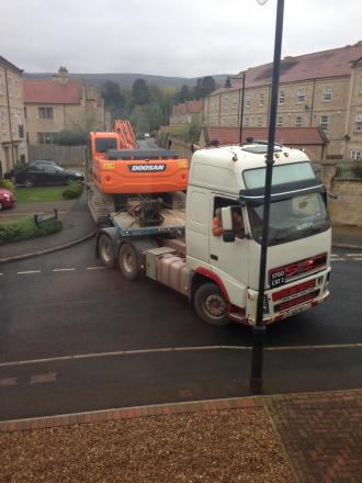 A truck negotiating a tight turn in the streets around the development at the Moor Lane Centre site, Burley-in-Wharfedale