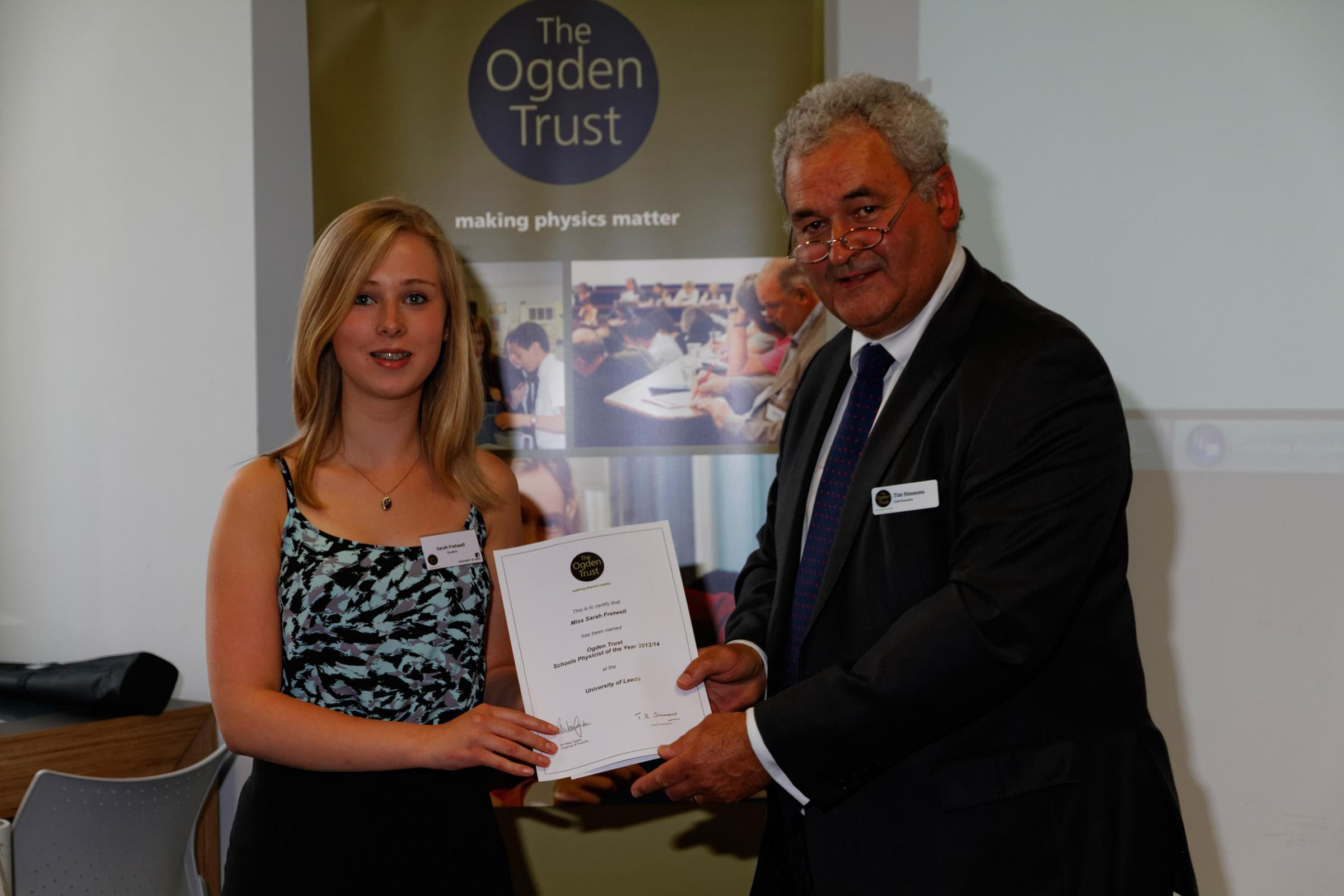 South Craven School pupil Sarah Fretwell being presented with her award by Tim Simmonds, chief executive officer of the Ogden Trust