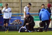 Guiseley's Ryan Toulson receives treatment after his serious leg injury