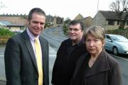 Councillor Ryk Downes with local residents and town councillors Jim and Pauline Spencer on Burras Lane, Otley