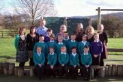 Ashfield Primary School headteacher Sybil Parker (back row, centre), who retired this week, celebrating an improved Ofsted rating with colleagues and pupils in 2012.