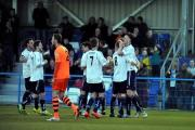 Guiseley team-mates help Jake Lawlor celebrate his match-winning goal  Pictures: Andy Garbutt