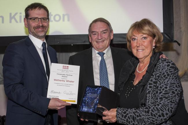 Philip and Janine Murphy, of the Wetherby Whaler receive their award in recognition of their fundraising efforts for the Yorkshire Air Ambulance from Sion Kingston of award sponsors Irwin Mitchell
