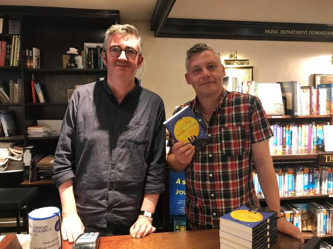Mike Sansbury, manager of The Grove Bookshop in Ilkley is pictured (left) with author David M. Barnett