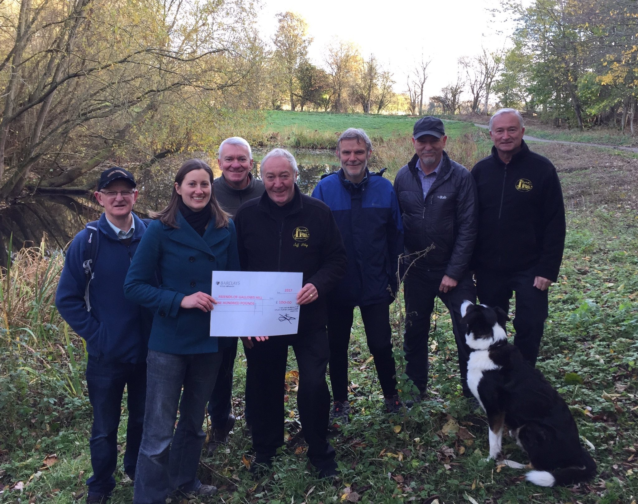 Karen Rumsey from the Friends of Gallows Hill receiving a cheque from Jeff Utley and fellow organisers of Otley Beer Festival, with Town Council Chair Ray Georgeson (second from right, back row)