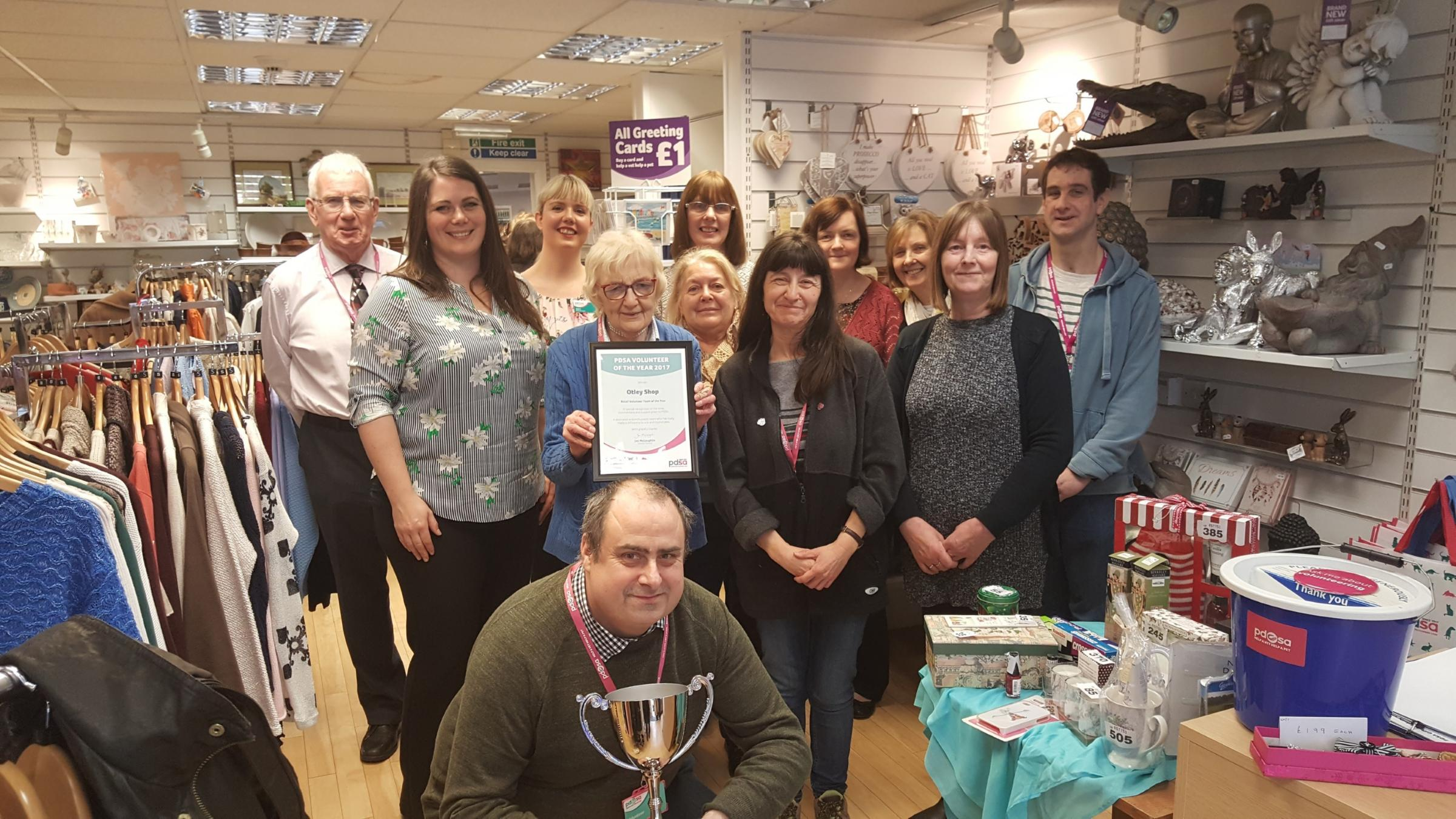 Volunteers at Otley's PDSA charity shop receiving their Retail Team of the Year award from Caroline Talbot (second from left)