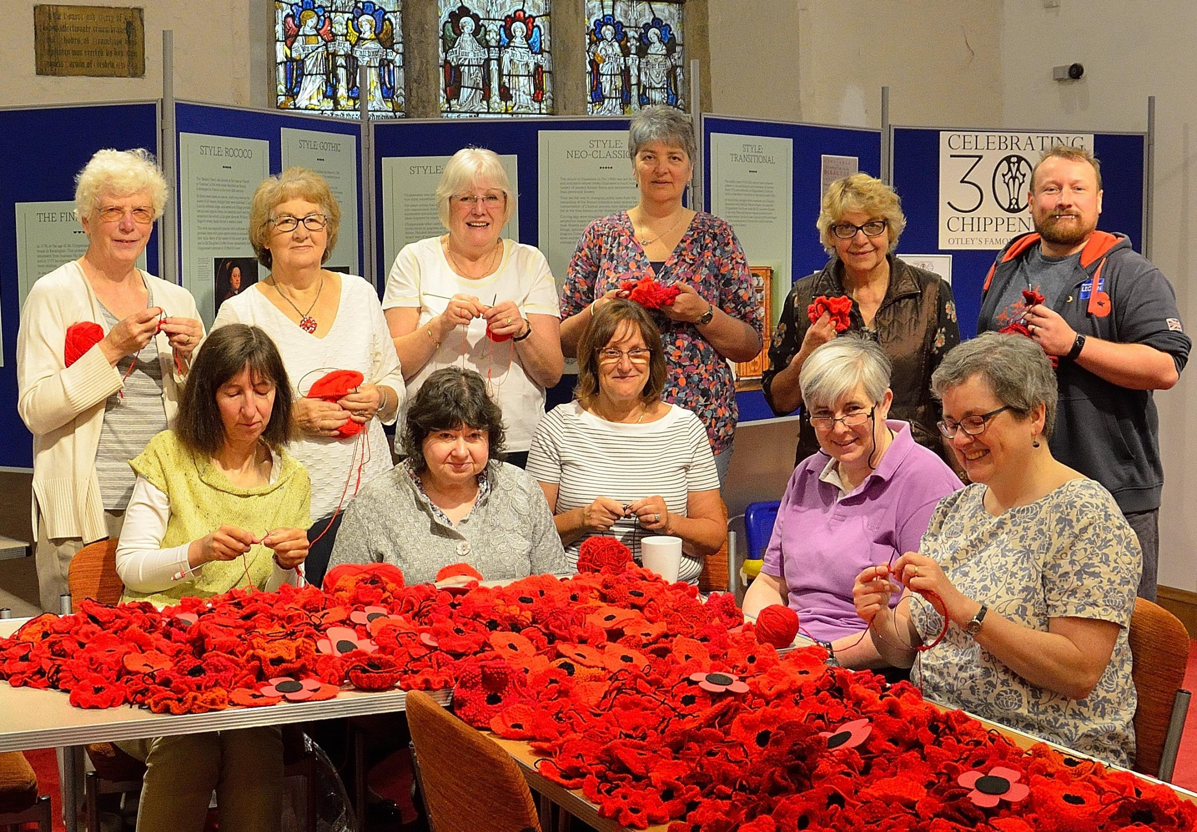 Aiming to create 14,000 poppies for an exhibit at Otley Parish Church - members of the Knit and Natter group