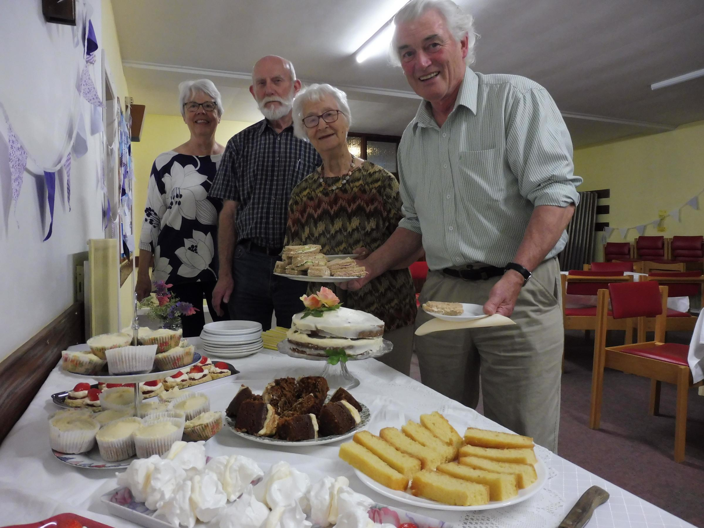 Pictured are some of the volunteers at the Ilkley and District Good Neighbours tea party – John Hall (holding plate) David Nuttall, Felicity White and Past Ansell