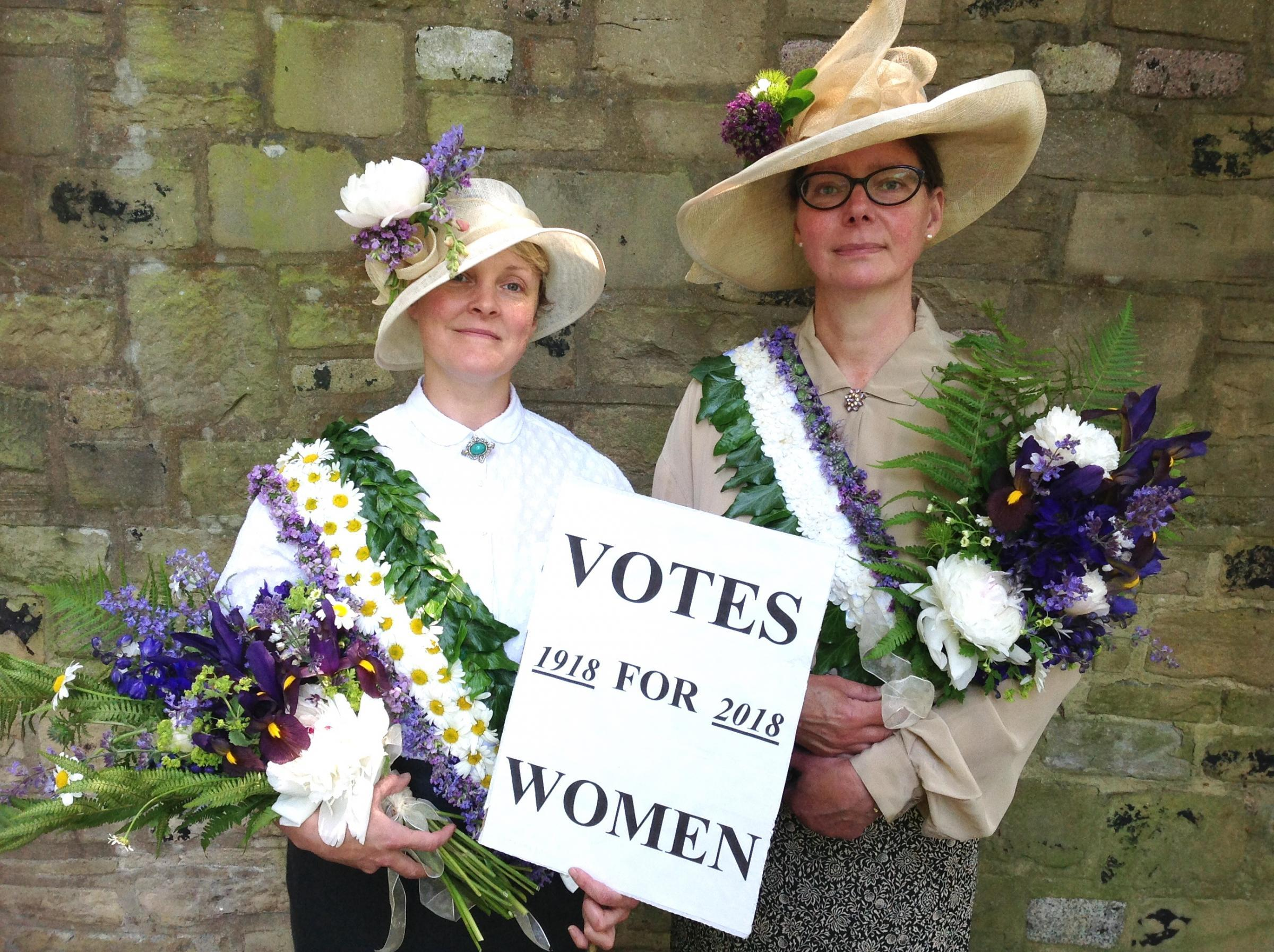 Jane Tucker (left) and Susanne Loweth with their floral tributes to the Suffragettes who achieved the first votes for women 100 years ago this year