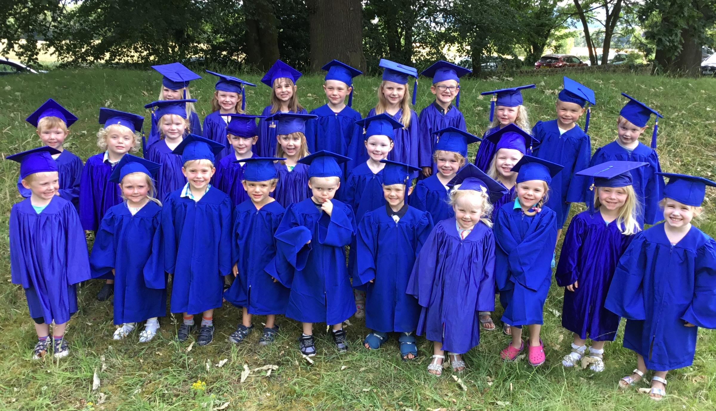 Celebrating their 'graduation day' - children at Chapter One Childcare, Farnley