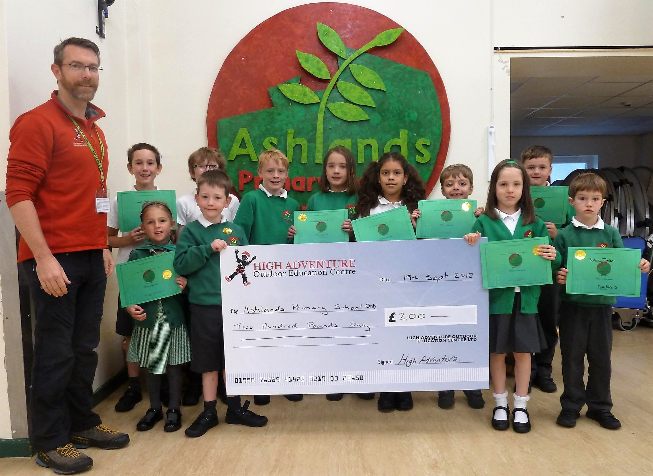 Pupils at Ashlands Primary School, Ilkley, receiving a donation from High Adventure Outdoor Education Centre