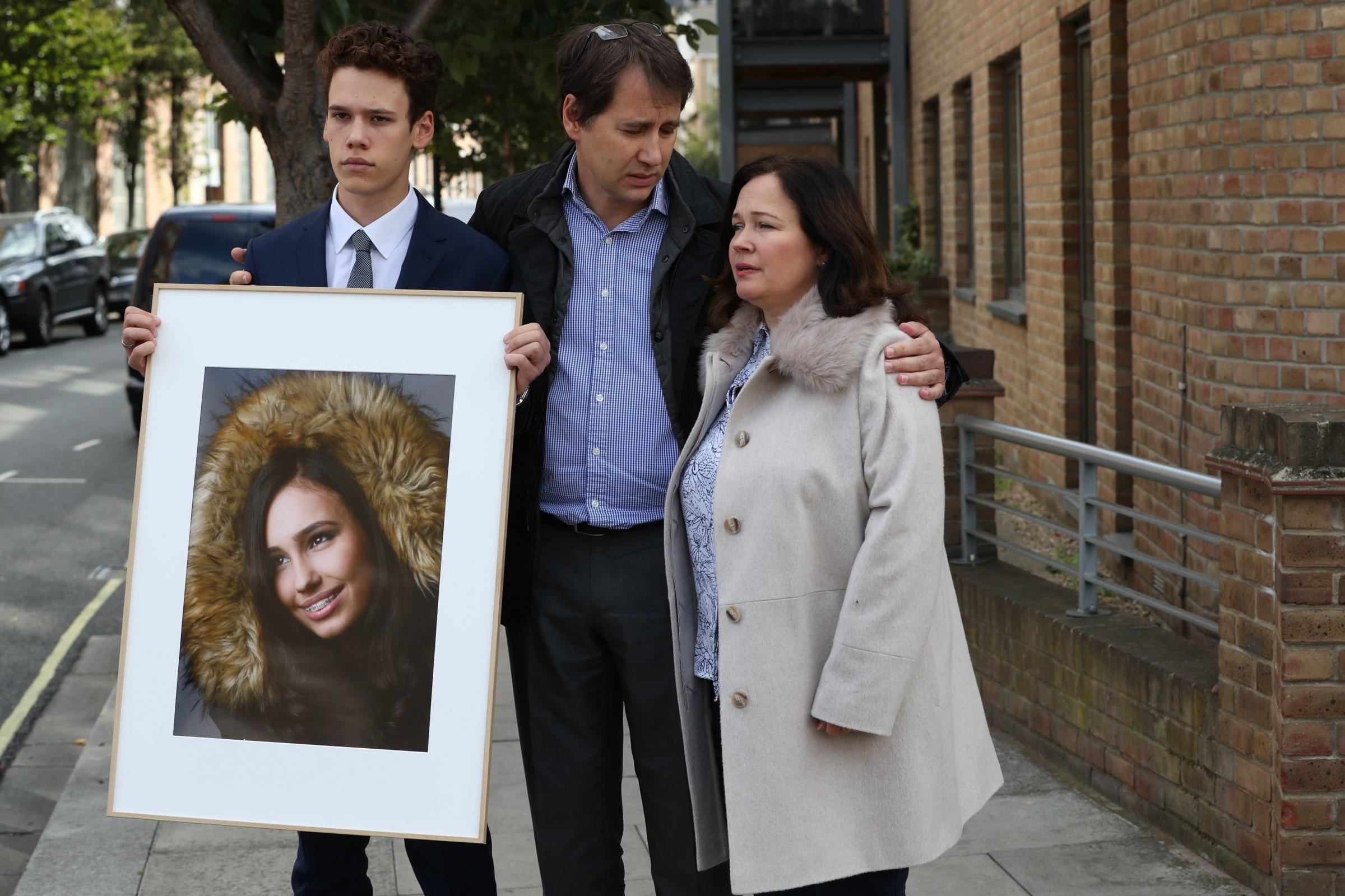 Nadim and Tanya Ednan-Laperouse with their son Alex outside West London Coroner's Court