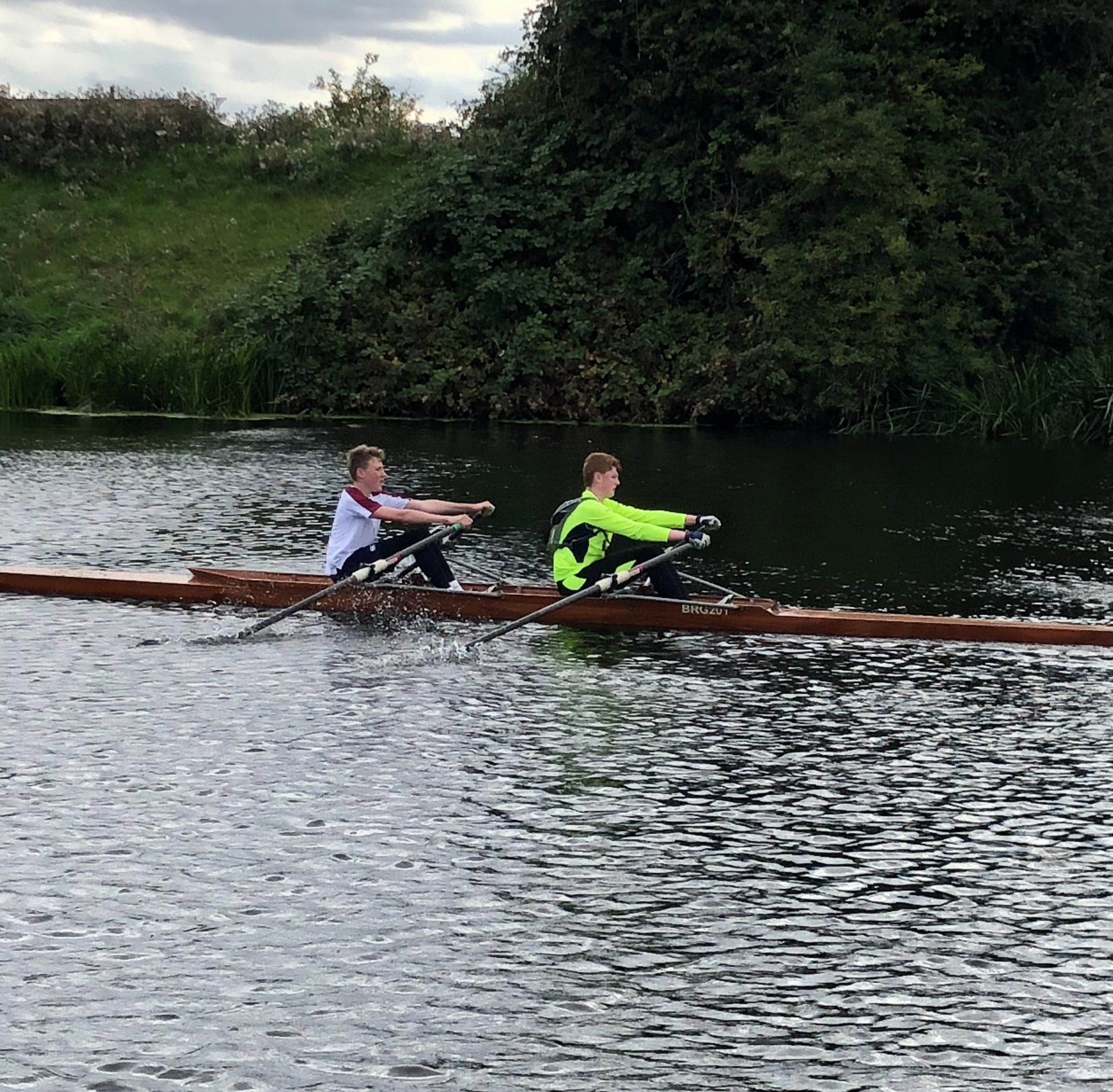 Harry Burns and Ruairi Hawthorn are pictured taking part in the Boston rowing marathon