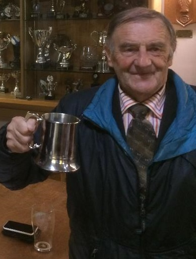Don Summersgill was presented with an inscribed tankard for serving 50 years as an umpire in Aire-Wharfe Cricket League