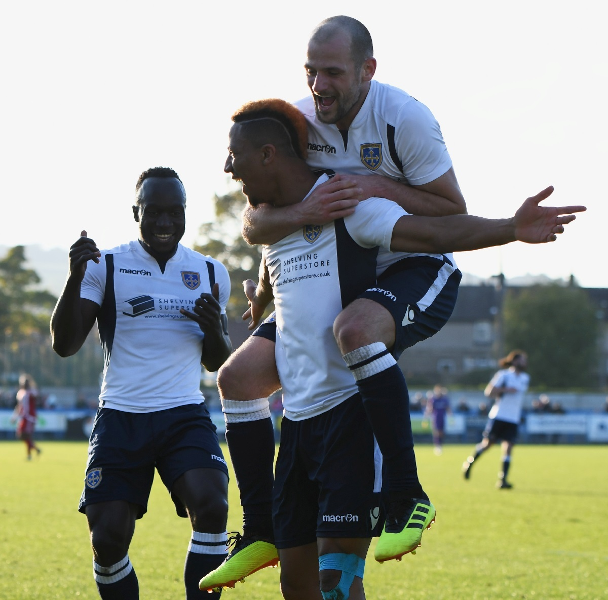 Kaine Felix celebrates with his arms outstretched to ensure Guiseley made it through to the FA Cup First Round Picture: Phil Whiteley