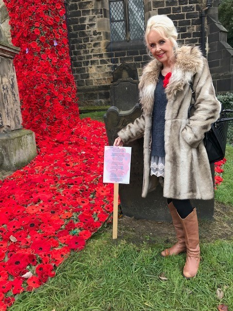 Barbara Marshall Corney at Otley Parish Church with one of her Remembrance inspired poems