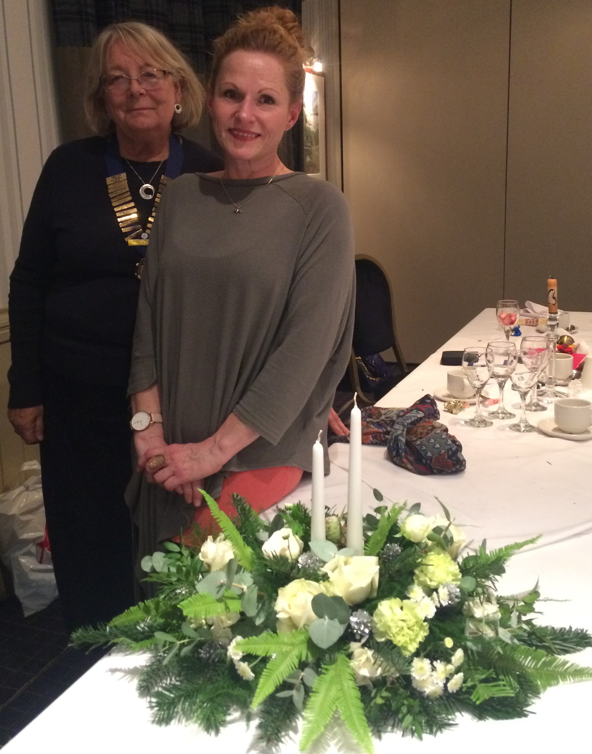 President of Otley Chevin Inner Wheel, Jennifer Angus, with Claire Glover from Casa Vitae and her Christmas table flower arrangement