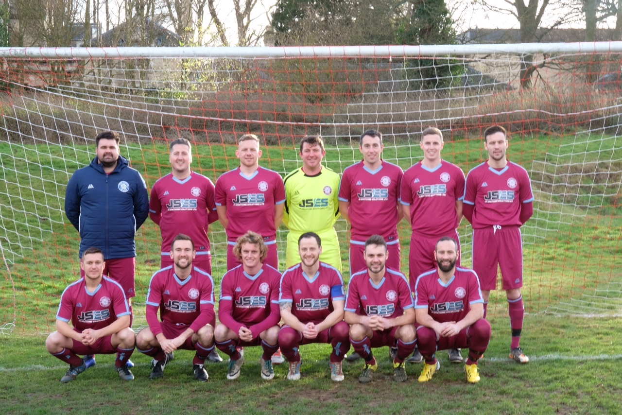 Burley Trojans in their new strip with manager Tom Higman in the back row on the left