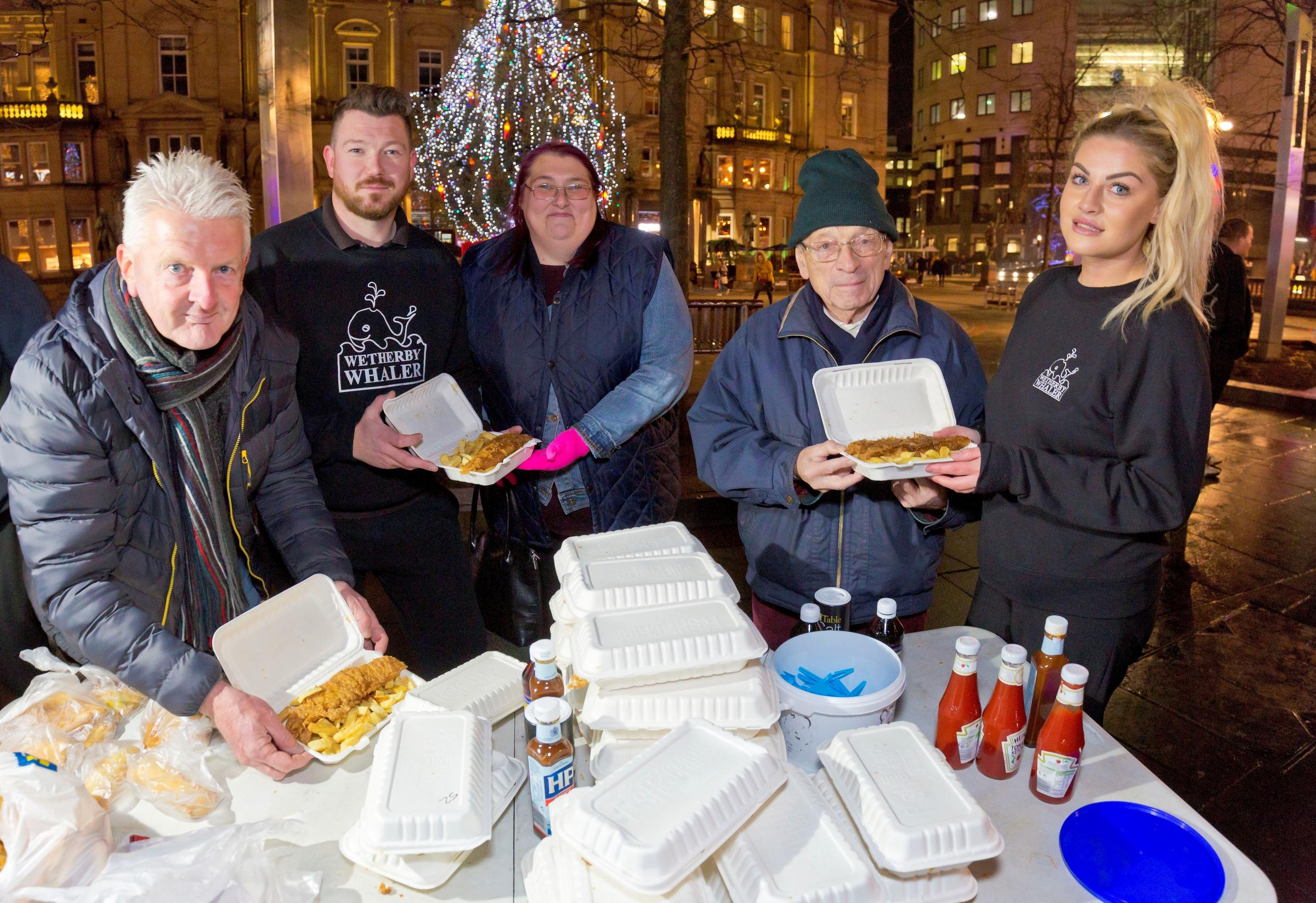 Kevin Bell (far left) from Leeds Homeless Partnership helps to hand out fish and chips with Owen Sharp and Joanne Jordan (far right) from Wetherby Whaler.  Matt Roberts