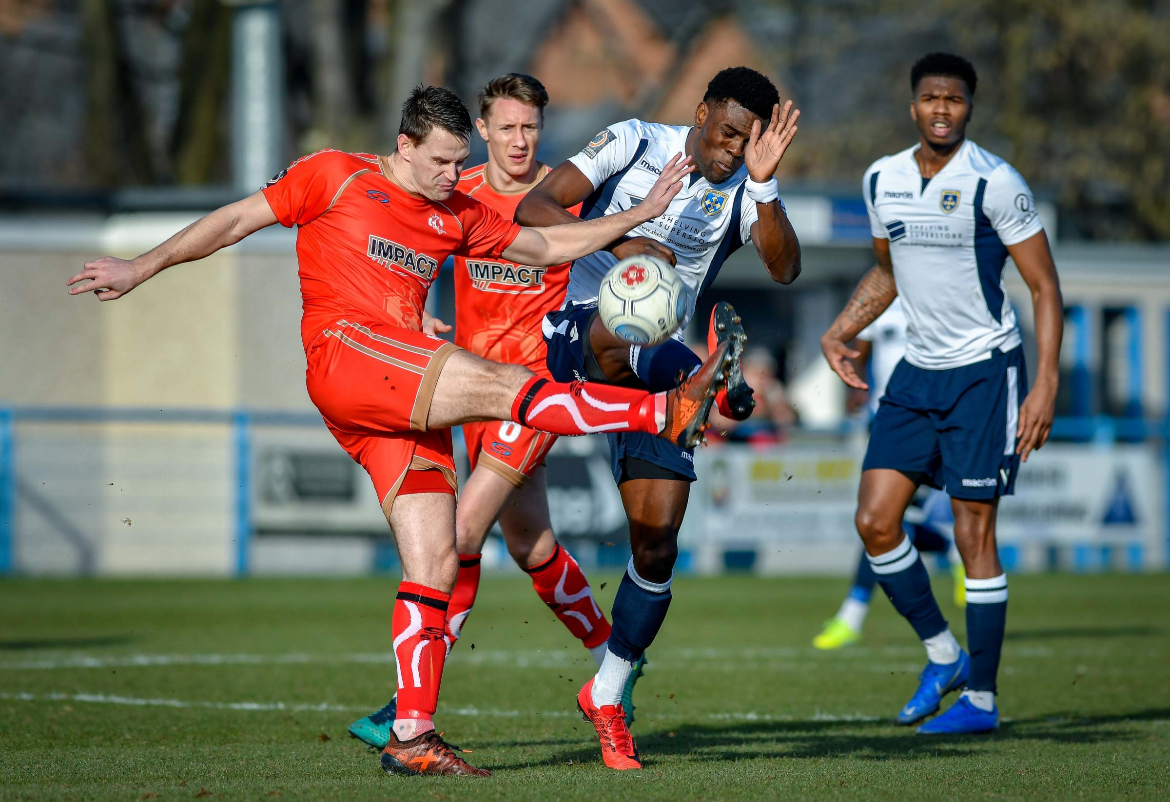 Guiseley striker Kayode Odejayi, right, battles for the ball in his side's 1-0 defeat to Alfreton Town in the Vanarama National League North on Saturday. Picture: Andy Garbutt