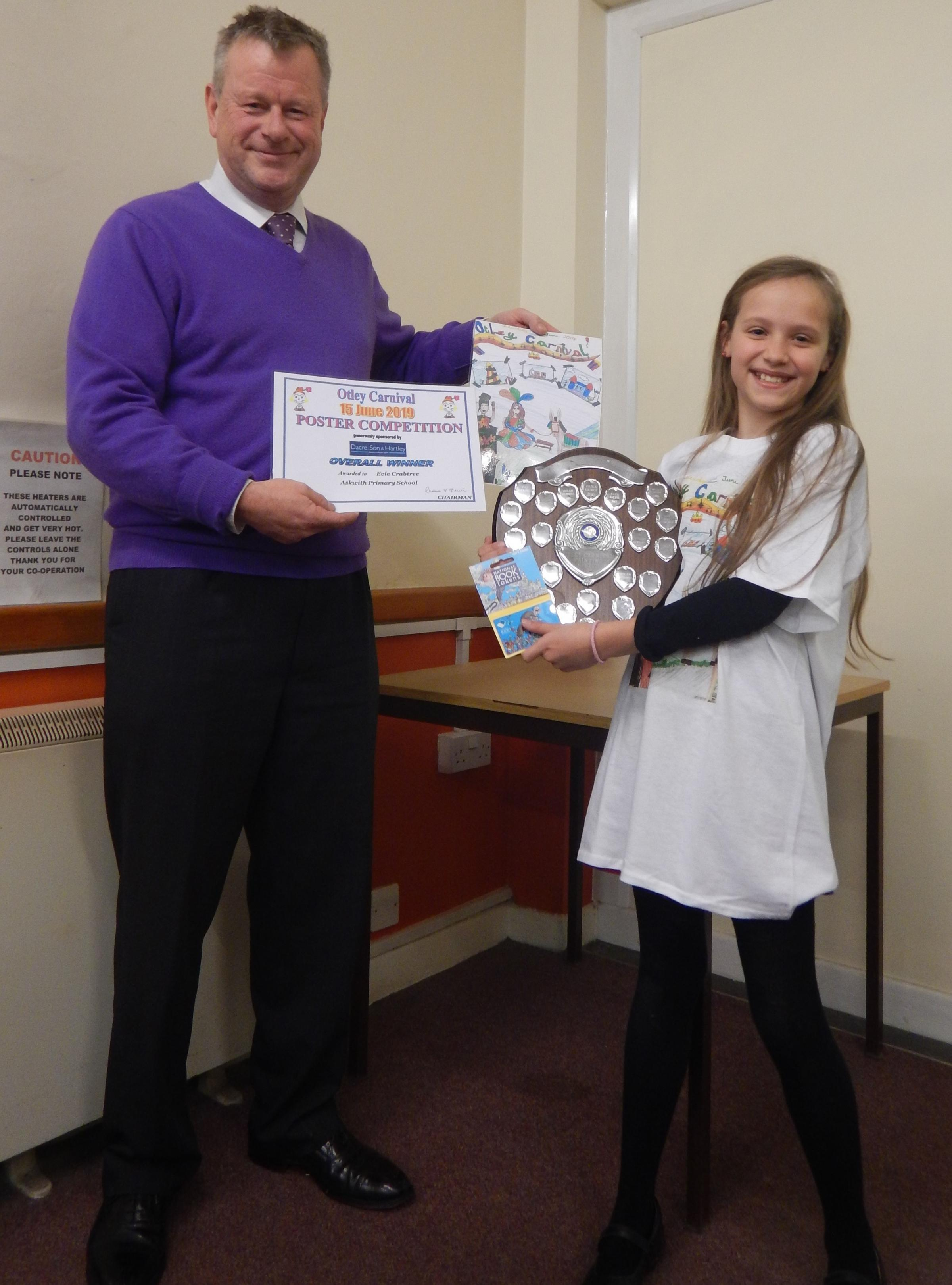 Tim Usherwood of Dacre Son & Hartley presenting Otley Carnival Poster Competition winner Evie Crabtree with her prizes