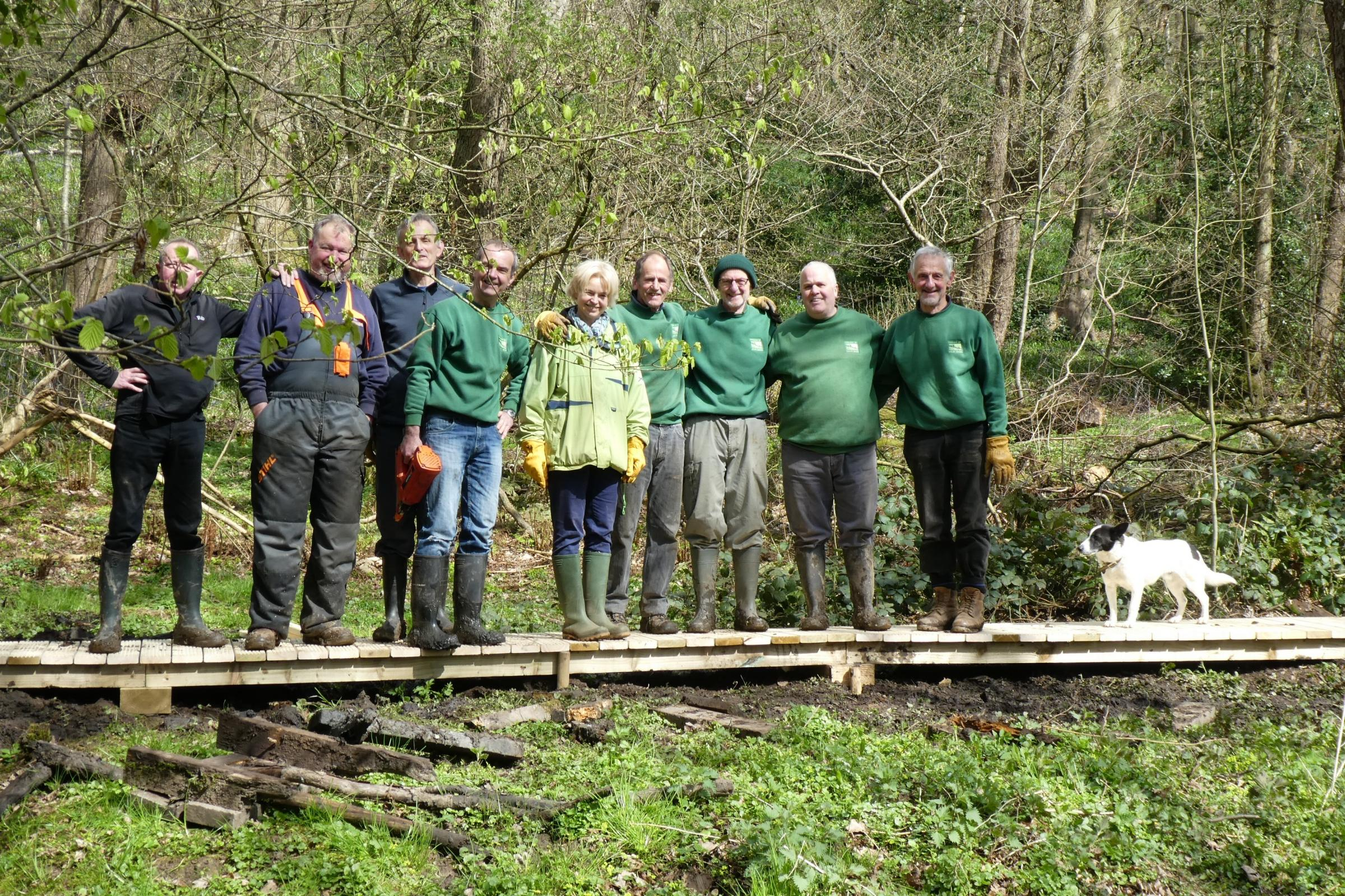 Friends of Ilkley Moor volunteers are pictured after completing a section of the boardwalk