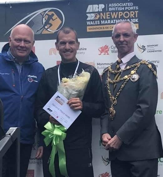 Otley AC's Scott Harrington, centre, finished second in the Newport Marathon
