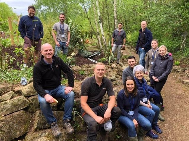 Green fingered staff from Linley & Simpson in the jungle garden at Martin House Hospice, Boston Spa