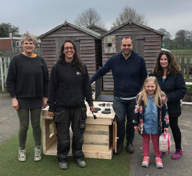 Leeds Wood Recycling studetns presenting a mud kitchen to Ashfield Primary School