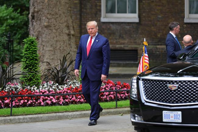 US President Donald Trump arrives in Downing Street, London, during his state visit (Aaron Chown/PA)