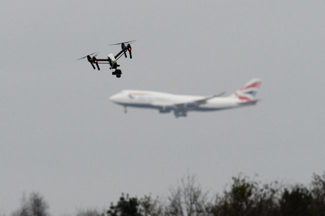 An aeroplane and a drone